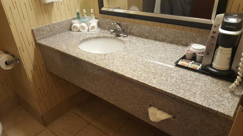 beige brown vanity with oval sink wall2wall shown